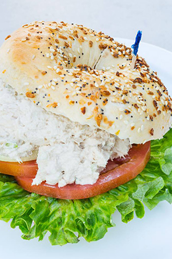 bagel with tomatoes, lettuce, and shmear